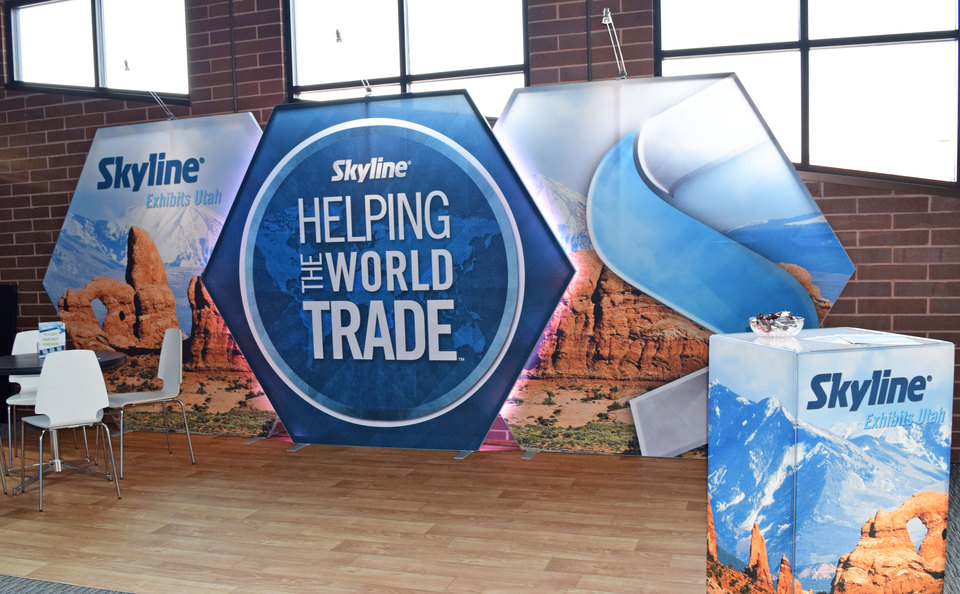 Skyline Exhibits Utah Backlit Inline Trade Show Display with Tables