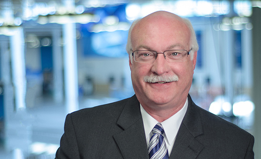 PAUL BALUS, SENIOR DIRECTOR, SALES (Directeur Général des Ventes)