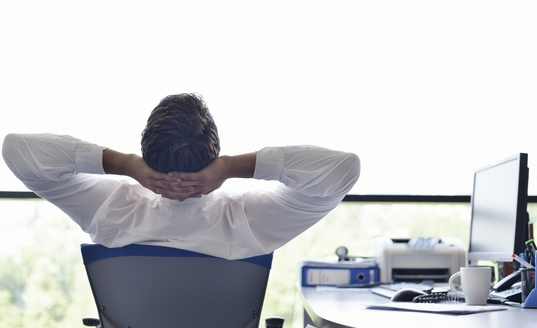 Man at office desk skyline pittsburgh