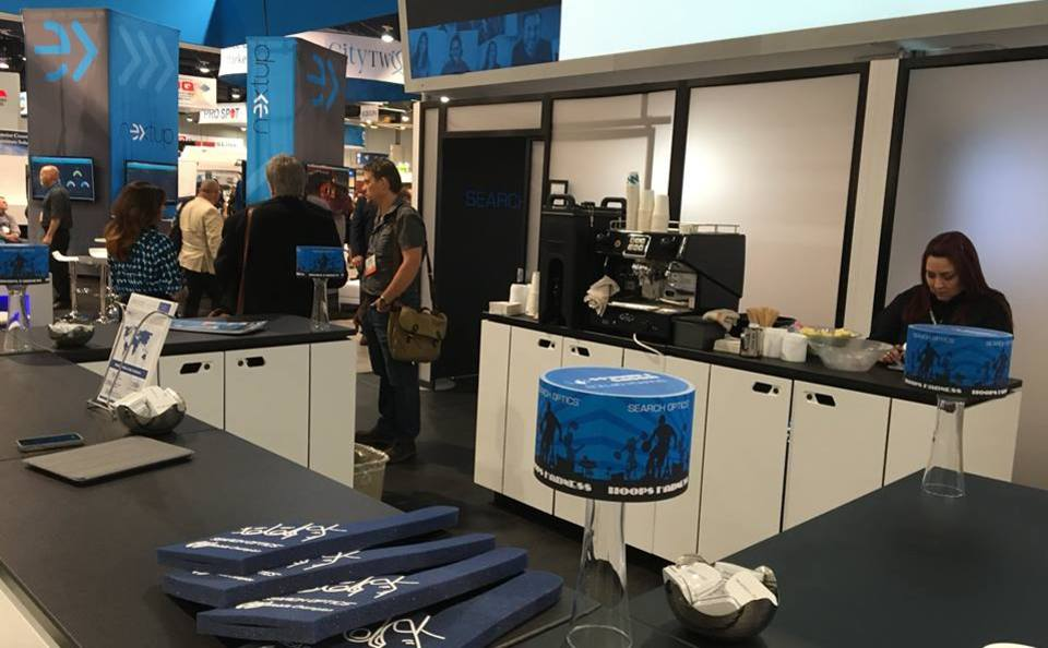 Trade show booth featuring coffee bar in Search Optics display at NADA 2016