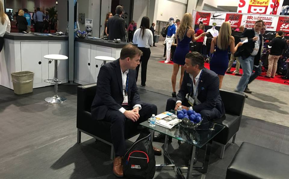 One on one meeting within lounge area of Search Optics trade show display at NADA 2016